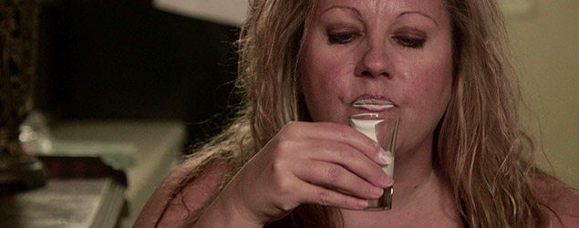 Heather Beal drinking from a shot glass (Discovery)