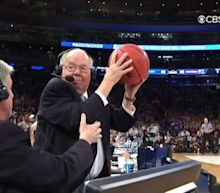 Verne Lundquist catches loose basketball a week after getting hit in the face by one