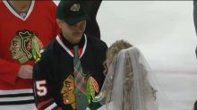 Blackhawks fan marries Wild fan on ice, betrays team