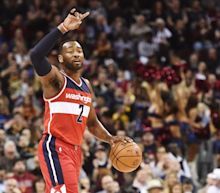 John Wall showed his growth as a point guard and picked apart the Cavaliers