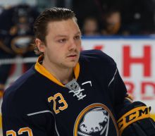 Sam Reinhart dressed for game, benched for breaking team rule