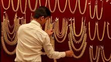 Gold holds near one-month peak as dollar and stock markets soften