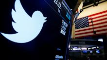 Twitter smashes expectations, announces job cuts