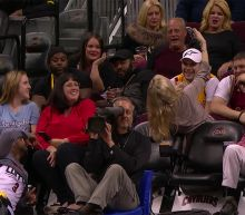 Chris Paul poses for selfie with fan during Clippers' blowout of Cavs