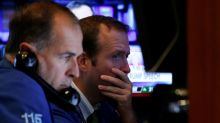 Wall Street slips on earnings; Apple falls late after results