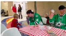 Jason Spezza is so proud of his paper bag puppet at the Stars' children's hospital visit